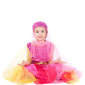 Pretty little girl sitting in costume — Stock Photo