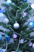 Baubles on Christmas tree — Stock Photo