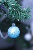 Blue bauble on Christmas tree — Stock Photo