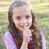 Little girl gesturing hush sign — Stock Photo