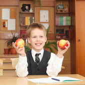 Little boy with apples — Stock Photo