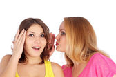 Young girl telling news to friend — Stock Photo