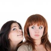 Pretty girl whispering to her friend — Stock Photo