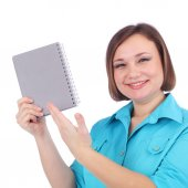 Pretty young woman with writing book — Stock Photo