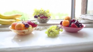 Different Summer fruits on a window sill — Stock Video