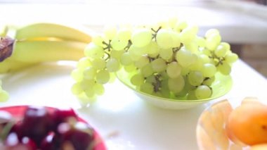 Different Summer fruits on a table — Stock Video