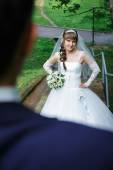 Bride standing on a staircase. — Stock Photo