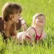 Happy mother and daughter in the grass — Stock Video #76852291