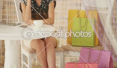 Beautiful young woman sitting at cafe — Stock Video