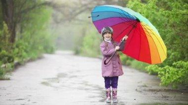 Little girl  jumping in the rain — Stock Video