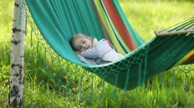 Girl sleeping in a hammock — Stock Video