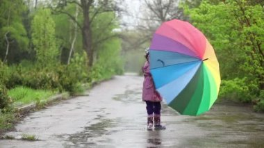 Girl with umbrella in hands spinning — Stock Video