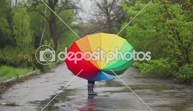 Girl catching  raindrops — Stock Video