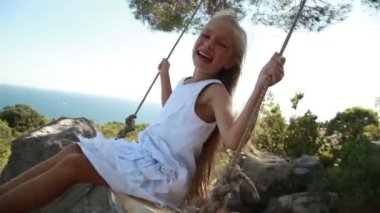 Laughing girl on  swing. — Stock Video