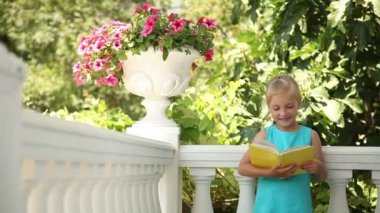 Happy girl reading a book — Stock Video