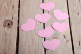 Pink paper Saint Valentines hearts — Stock Photo