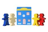 Wooden Figures and Building — Stock Photo