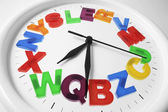 Plastic Alphabets on Wall Clock — Stock Photo