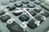 Clock Hands and Calculator Keys — Stock Photo