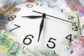 Clock and Bank Notes — Stock Photo