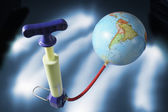 Miniature Pump Attached to Globe — Stock Photo