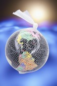 Globe Wrapped with Soft Fishnet Material — Stock Photo
