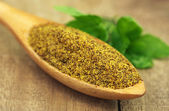 Grated mustard seeds with green herbs — Stock Photo