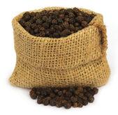 Black peppercorns in sack — Stock Photo