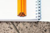 Note book and pencils — Stock Photo