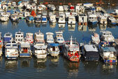 Various parked boats in row — Stock Photo