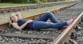Woman lying on rail track — Stock Photo