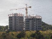 Construction crane on the beach. Crimea — Stock Photo