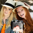 Two teenagers girl taking selfe with camera — Stock Photo #52247653