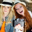 Two teenagers girl taking selfe with camera — Stock Photo #52247683