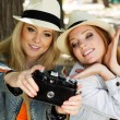 Two teenagers girl taking selfe with camera — Stock Photo #52247783