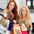 Two attractive happy girls out shopping — Stock Photo #52355385