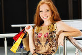 Attractive happy girl out shopping — ストック写真