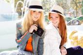 Two teenagers girl taking selfe with camera — Stock Photo