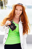 Nice girl photographer at work — Stock Photo