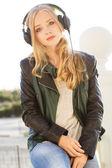 Young happy teenager is wearing headphones — Стоковое фото