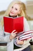 Young beautiful girl with a books — Stock Photo