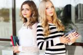Two teenager girls with books — Stock Photo