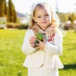 Child with green apples sitting on grass — Stock Photo #54653247