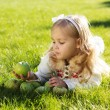 Child with green apples sitting on grass — Stock Photo #54653251