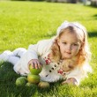 Child with green apples sitting on grass — Stock Photo #54890207