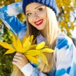 Autumn woman happy with colorful fall leaves — Stock Photo #55419021