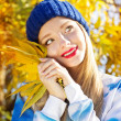 Autumn woman happy with colorful fall leaves — Stock Photo #55419045