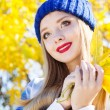 Autumn woman happy with colorful fall leaves — Stock Photo #55419095