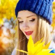 Autumn woman happy with colorful fall leaves — Stock Photo #55419139