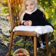 Adorable little girl with apples, autumn time — Stock Photo #55618963